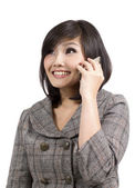 Young business woman talking on cell phone — Stock Photo