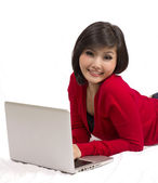 Pretty young girl using laptop — Stock Photo