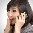 Young Asian businesswoman exited while talking on cellphone — Stock Photo #9502348