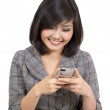 Young business woman reading text message on mobile phone — Stock Photo #9503182