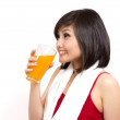 Pretty asian girl drinking orange juice after exercise — Stock Photo #9504023