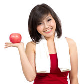 Pretty Asian woman showing an apple on her hand — Photo