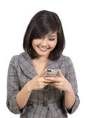 Young business woman reading text message on mobile phone — Stock Photo