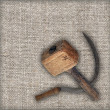 Old sickle and hammer on canvas — Stock Photo
