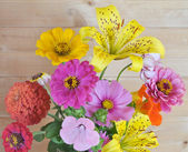 Flowers and wooden wall — Stock Photo