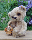 Teddy-bear Lucky with a rag doll — Stock Photo