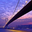 Tsing Ma Bridge at night - Stock Photo