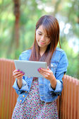 Young asian woman with tablet pc — Stock Photo