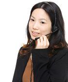 Asian woman wearing headset — Stock Photo