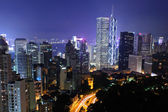 Hong kong con edifici affollati di notte — Foto Stock