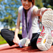 Sporty asian girl doing stretching exercise — Stock Photo #8265393