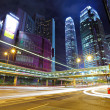 Light trails in mega city at night — Stock Photo