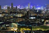 Hong kong s přeplněných budov v noci — Stock fotografie