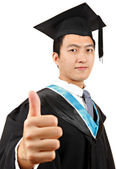 Graduate student with thumb up — Stock Photo