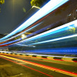Light trails in mega city highway - Stock Photo