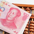 Abacus and china money banknote — Stock Photo #8406481