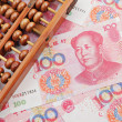 Abacus and china money banknote — Stock Photo #8406507