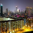 Hong Kong downtown with many building at night — Stock Photo