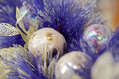 Christmas ball on blue color christmas tree — Стоковое фото