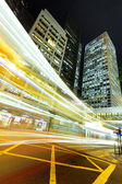 Light trails in modern city — Stock Photo