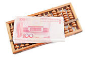 Abacus and china money banknote — Stock Photo