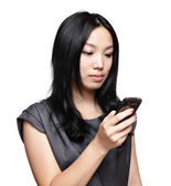 Girl sms on mobile phone — Stock Photo