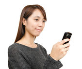 Girl read sms on phone — Stock Photo