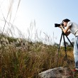 Photographer taking photo in wild — Stock Photo