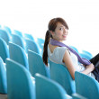 Sporty girl sit in sport arena — Stock Photo #9179840