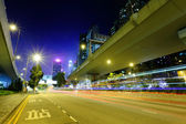 Highway light trails in city — 图库照片