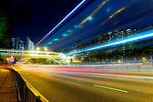 Night traffic light trail in city — Stock Photo