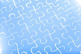 Puzzle in blue — Stock Photo