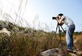 Photographer taking photo in wild — Stock Photo