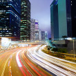 Futuristic urban city with car light — Stock Photo