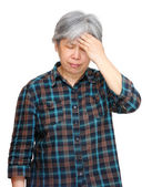 Mature asian woman with headache — Stock Photo