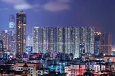 Hong Kong with crowded buildings at night — Stock fotografie