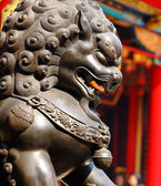 Bronze lion in chinese temple — Stock Photo