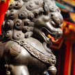 Metal lion in chinese temple - Stock Photo