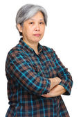 Mature asian woman over white background — Stock Photo