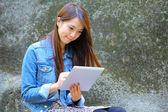 Beautiful asian woman using tablet computer — Stock Photo