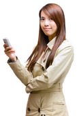 Asian young woman using mobile phone message — Stock Photo