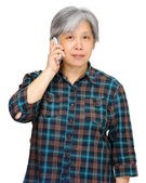 Mature woman using mobile phone — Stock Photo