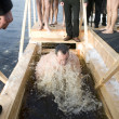 Stock Photo: Bathing in consecrated water of river Daugavin Rig(L