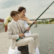 Stock Photo: Successful fishing of newly-married couple