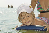 The child floats — Stock Photo