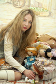 Woman and dolls — Stock Photo