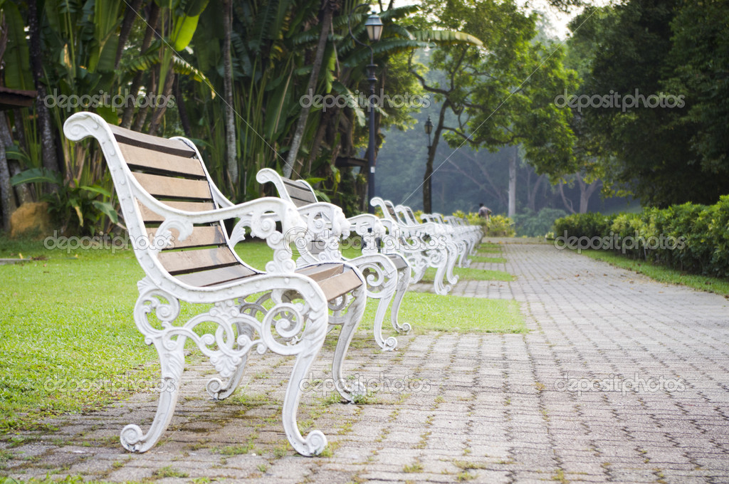 Empty bench in a park, nobody is around as time passing. — Stock Photo #8459791