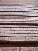 Red Brick Wall with grooves going upward — Stock Photo