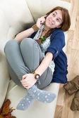 Beautiful teen girl with phone — Stock Photo