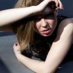 Girl in combi dress under harsh sun light — Stock Photo #10135157
